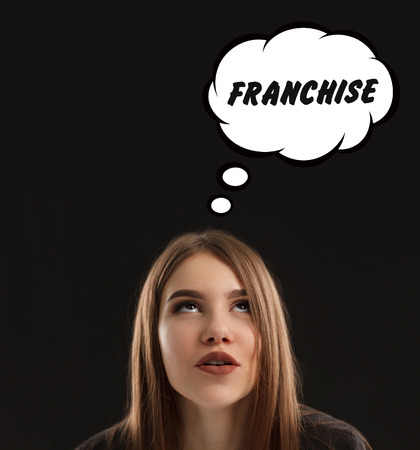 The concept of marketing, technology, the Internet and the network. The young entrepreneur gets an idea: Franchise Foto de archivo