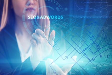 The concept of business, technology, the Internet and the network. A young entrepreneur working on a virtual screen of the future and sees the inscription: SEO&AdWords
