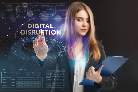 The concept of business, technology, the Internet and the network. A young entrepreneur working on a virtual screen of the future and sees the inscription: digital disruption
