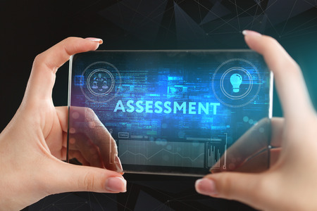 The concept of business, technology, the Internet and the network. A young entrepreneur working on a virtual screen of the future and sees the inscription: assessment
