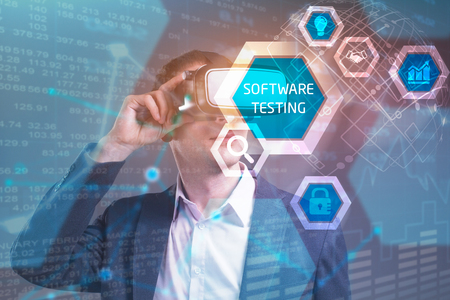 Business, Technology, Internet and network concept. Young businessman working in virtual reality glasses sees the inscription: Software testing Stock Photo