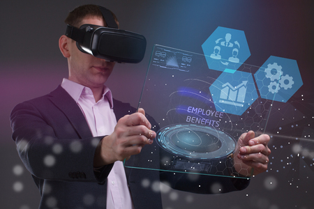 The concept of business, technology, the Internet and the network. A young entrepreneur working on a virtual screen of the future and sees the inscription: Employee benefits
