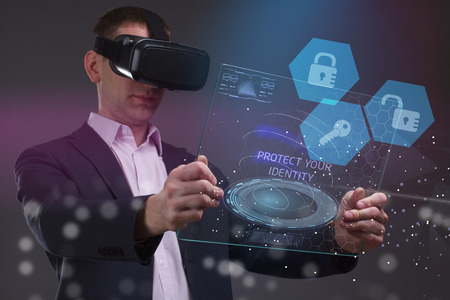 The concept of business, technology, the Internet and the network. A young entrepreneur working on a virtual screen of the future and sees the inscription: Protect your identity