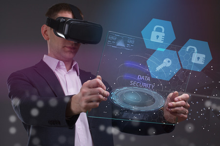 The concept of business, technology, the Internet and the network. A young entrepreneur working on a virtual screen of the future and sees the inscription: Data security Stock Photo