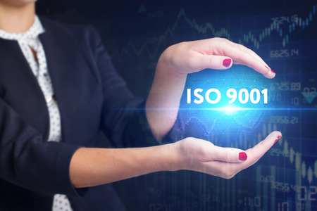 The concept of business, technology, the Internet and the network. A young entrepreneur working on a virtual screen of the future and sees the inscription: ISO 9001 Stock Photo