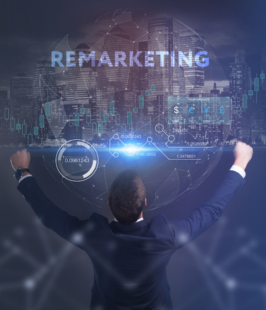 The concept of business, technology, the Internet and the network. A young entrepreneur working on a virtual screen of the future and sees the inscription: Remarketing Stockfoto