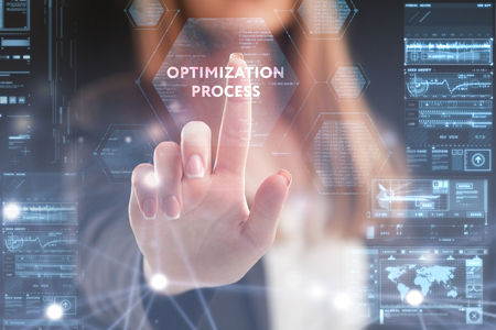 The concept of business, technology, the Internet and the network. A young entrepreneur working on a virtual screen of the future and sees the inscription: Optimization process