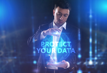 The concept of business, technology, the Internet and the network. A young entrepreneur working on a virtual screen of the future and sees the inscription: Protect your data 版權商用圖片