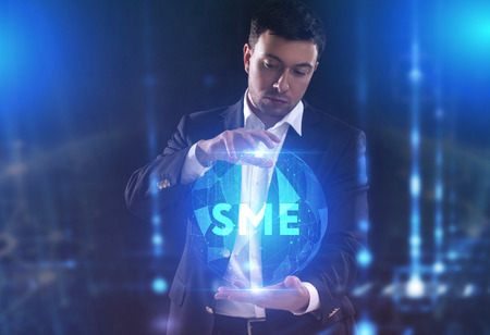 The concept of business, technology, the Internet and the network. A young entrepreneur working on a virtual screen of the future and sees the inscription: SME