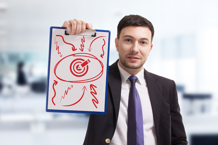 Business, technology, internet and networking concept. Young entrepreneur showing keyword: target