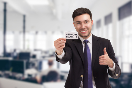 Business, technology, internet and networking concept. Young entrepreneur showing keyword: Network security Stock Photo