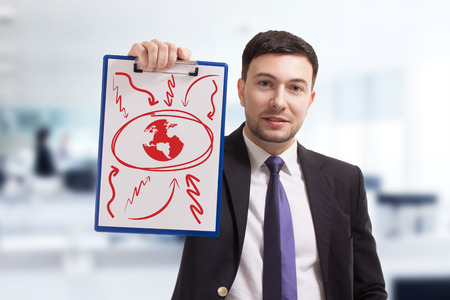 Business, technology, internet and networking concept. Young entrepreneur showing keyword:earth Stock Photo