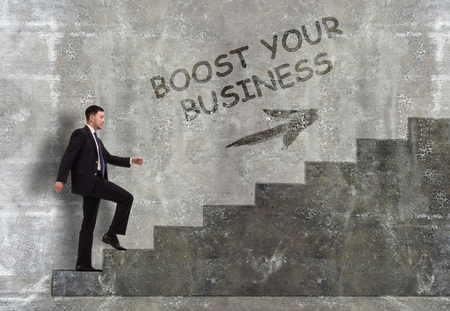 Business, technology, internet and networking concept. A young entrepreneur goes up the career ladder: Boost your business