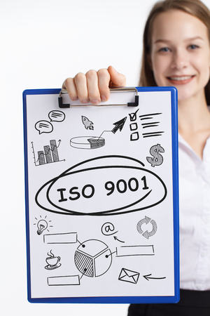 Business, technology, internet and networking concept. Young entrepreneur showing keyword: ISO 9001
