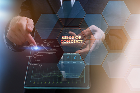 The concept of business, technology, the Internet and the network. A young entrepreneur working on a virtual screen of the future and sees the inscription: Code of conduct Standard-Bild