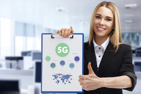 Business, technology, internet and networking concept. Young entrepreneur showing keyword: 5G