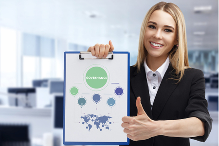 Business, technology, internet and networking concept. Young entrepreneur showing keyword: Governance Stock Photo