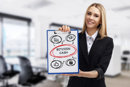 Business, technology, internet and networking concept. Young entrepreneur showing keyword: Bitcoin cash