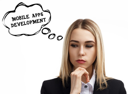 Business, technology, internet and networking concept. A young entrepreneur is thinking about the meaning of a keyword: Mobile apps development Stock Photo