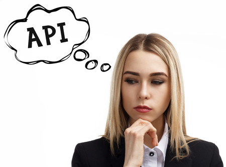 Business, technology, internet and networking concept. A young entrepreneur is thinking about the meaning of a keyword: API