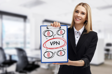 Business, technology, internet and networking concept. Young entrepreneur showing keyword: VPN Stock Photo