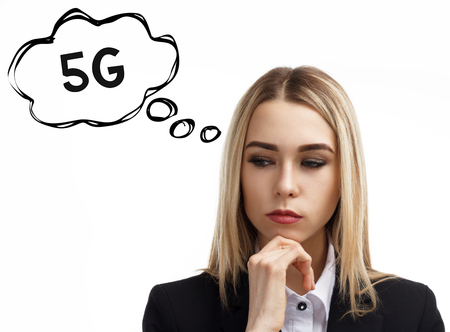 Business, technology, internet and networking concept. A young entrepreneur is thinking about the meaning of a keyword: 5G Stock Photo