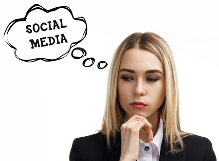 Business, technology, internet and networking concept. A young entrepreneur is thinking about the meaning of a keyword: Social media