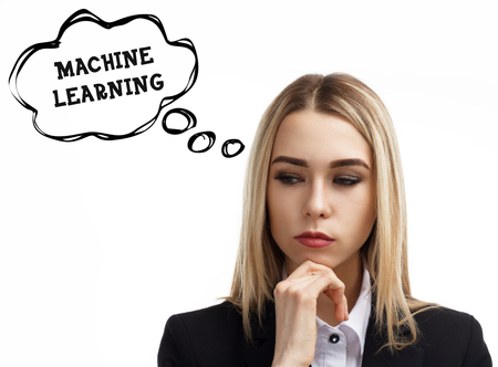 Business, technology, internet and networking concept. A young entrepreneur is thinking about the meaning of a keyword: Machine learning Stock Photo