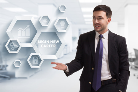 The concept of business, technology, the Internet and the network. A young entrepreneur working on a virtual screen of the future and sees the inscription: begin new career Banco de Imagens - 121137744