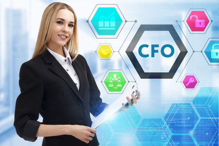 The concept of business, technology, the Internet and the network. A young entrepreneur working on a virtual screen of the future and sees the inscription: CFO 版權商用圖片