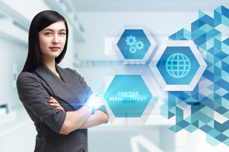 The concept of business, technology, the Internet and the network. A young entrepreneur working on a virtual screen of the future and sees the inscription: Change management Stock Photo