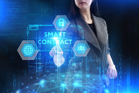 The concept of business, technology, the Internet and the network. A young entrepreneur working on a virtual screen of the future and sees the inscription: Smart contract Stockfoto