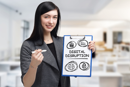 Business, technology, internet and networking concept. Young entrepreneur showing keyword: digital disruption