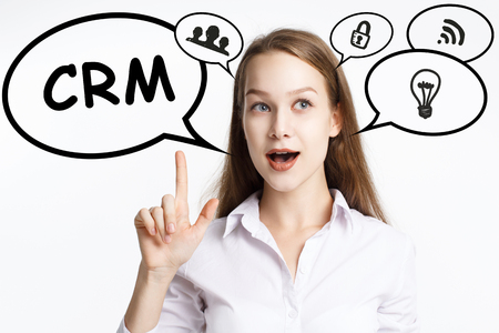 Business, technology, internet and networking concept. A young entrepreneur comes to mind the keyword: CRM