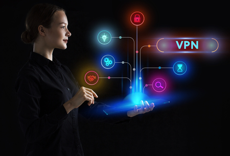 The concept of business, technology, the Internet and the network. A young entrepreneur working on a virtual screen of the future and sees the inscription: VPN Stockfoto