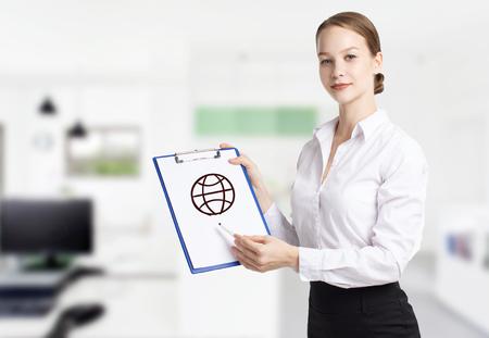 Business, technology, internet and networking concept. Young entrepreneur showing keyword: world Reklamní fotografie