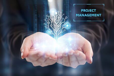 The concept of business, technology, the Internet and the network. A young entrepreneur working on a virtual screen of the future and sees the inscription: Project management 写真素材