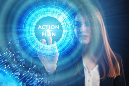 The concept of business, technology, the Internet and the network. A young entrepreneur working on a virtual screen of the future and sees the inscription: Action plan