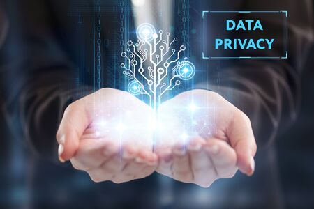 The concept of business, technology, the Internet and the network. A young entrepreneur working on a virtual screen of the future and sees the inscription: Data privacy 写真素材