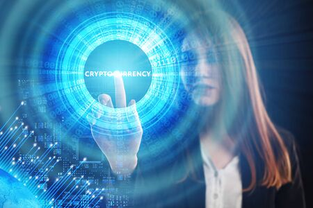 The concept of business, technology, the Internet and the network. A young entrepreneur working on a virtual screen of the future and sees the inscription: Cryptocurrency