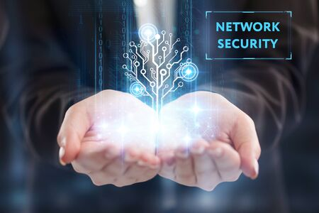 The concept of business, technology, the Internet and the network. A young entrepreneur working on a virtual screen of the future and sees the inscription: Network security 写真素材