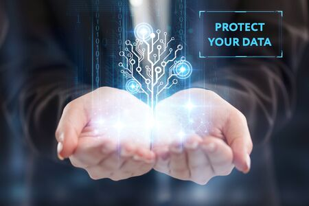 The concept of business, technology, the Internet and the network. A young entrepreneur working on a virtual screen of the future and sees the inscription: Protect your data 写真素材
