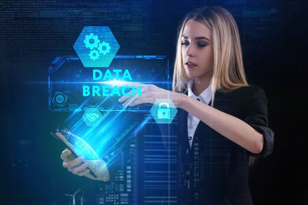 The concept of business, technology, the Internet and the network. A young entrepreneur working on a virtual screen of the future and sees the inscription: Data breach Banque d'images