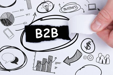 Business, technology, internet and networking concept. Young entrepreneur showing keyword: B2B Фото со стока