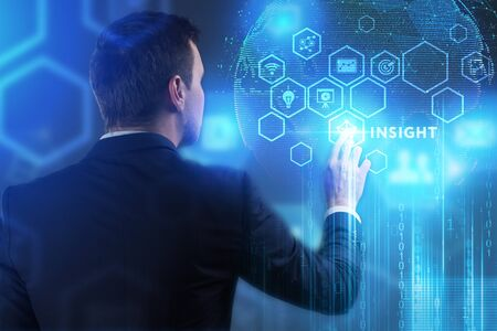 The concept of business, technology, the Internet and the network. A young entrepreneur working on a virtual screen of the future and sees the inscription: Insight