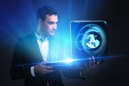 The concept of business, technology, the Internet and the network. A young entrepreneur working on a virtual screen of the future and sees the inscription: earth