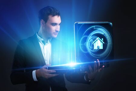 The concept of business, technology, the Internet and the network. A young entrepreneur working on a virtual screen of the future and sees the inscription: home