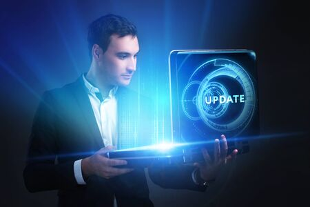 The concept of business, technology, the Internet and the network. A young entrepreneur working on a virtual screen of the future and sees the inscription: Update
