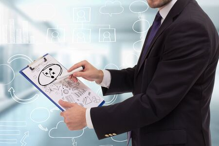 The concept of business, technology, the Internet and the network. A young entrepreneur working on a virtual screen of the future and sees the inscription: strategy
