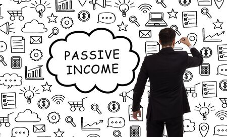 Business, technology, internet and networking concept. Young entrepreneur showing keyword: Passive income Фото со стока